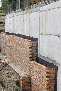 damp proofing brick and concrete wall