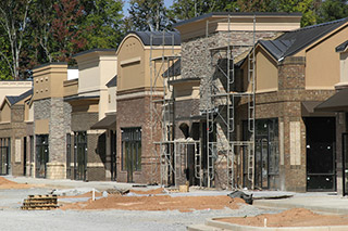 Commercial Buildings With Stone Veneer And Exterior Stucco