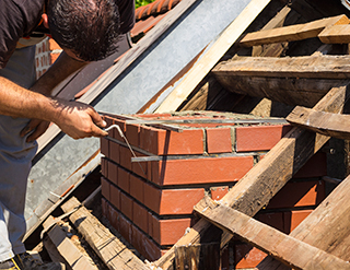 Worker Fixing Chimney Mortar