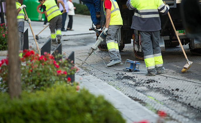 A Group of Workers Providing a Traffic Coating